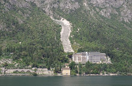 Hotel Panorama at Lake Garda. Part of a hill of Devonian shale was removed to make the road, forming a dip-slope. The upper block detached along a bedding plane and is sliding down the hill, forming a jumbled pile of rock at the toe of the slide. Limone sul Garda Hotel 001.JPG