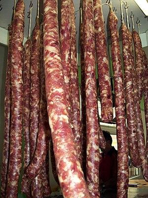 English: Brazilian Linguiça or pork sausage on...
