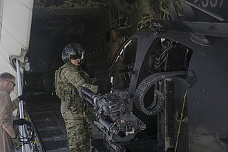 Boeing AH-6 - A/MH-6X with a GAU-19, being loaded into a KC-130J