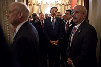 State of the Union - The Sergeants at Arms of the House (left) and Senate (right) wait at the doorway to the House chamber before President Barack Obama enters to deliver the 2011 State of the Union Address.