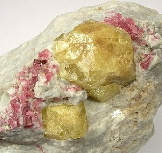 Borate minerals - Large (up to 1.8 cm) yellow londonite crystals associated with rubellite tourmaline. Londonite is an unusual caesium-rich heptaborate.