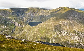 Mangerton Mountain - Mangerton (c) with the hanging lake of Lough Erhogh (c) and Mangerton North Top (r)