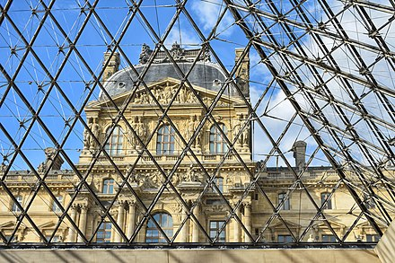 Inside the Pyramid: the view of the Louvre Museum in Paris from the underground lobby of the pyramid. Louvre Palace.jpg