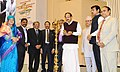 M. Venkaiah Naidu lighting the lamp at the Golden Jubilee celebrations of the Press Council of India, on the occasion of the National Press Day, in New Delhi.jpg