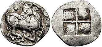 Amyntas I of Macedon - Coinage towards the end of the reign of Amyntas I, under the Achaemenids, Aegae, circa 510-480 BC. Goat kneeling right, head reverted; pellet above and before / Quadripartite incuse square.
