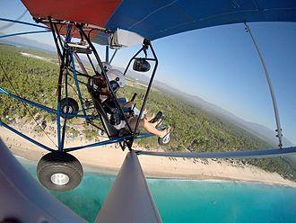 Mati, Davao Oriental - The Quicksilver Sport 2S of the Mindanao SAGA Flying Club flying over Dahican Beach