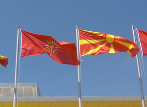 Flag of the Republic of Macedonia - The former and current flags of Macedonia in front of the Boris Trajkovski Sports Arena in Skopje