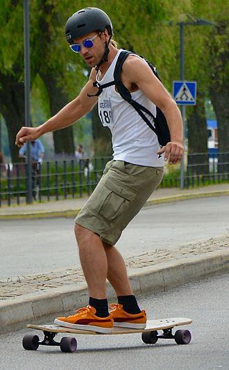 Longboard (skateboard) - Longboarder cruising