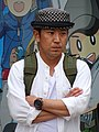 Man with Folded Arms on Street - Sapporo - Hokkaido - Japan (47971053382).jpg
