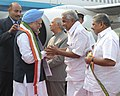 Manmohan Singh being received by the Governor of Kerala, Shri H. R. Bhardwaj, the Chief Minister, Kerala Shri Oommen Chandy and the Union Minister for Overseas Indian Affairs, Shri Vayalar Ravi.jpg