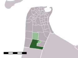 The town centre (dark green) and the statistical district (light green) of Julianadorp in the municipality of Den Helder.