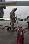 Marines deliver fuel to each other in prep for deployment 150426-M-CV548-003.jpg