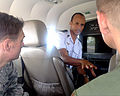 Mauritanian air force Capt. Eyoub Teyss, center, an intelligence, surveillance and reconnaissance (ISR) operations officer, briefs U.S. Air Force Maj. Michael Simons, left, the lead planner of African 140901-F-FV908-037.jpg