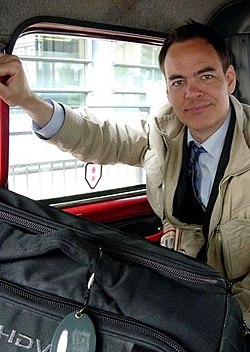 Max keiser in a london taxi.jpg