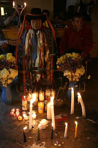 Maximón - Maximón effigy and candles, Santiago Atitlán