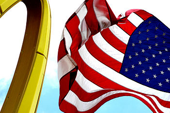 McDonald's arches + U.S flag. Synonymous, symb...