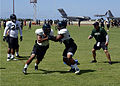 Members of the University Of Hawaii Rainbow Warrior football team practice at Earhart Field on Joint Base Pearl Harbor-Hickam Aug. 15, 2013, in Hawaii 130815-N-DT805-008.jpg