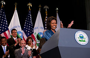 First Lady Michelle Obama applauds the staff m...