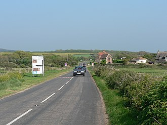 A3055 road - Military Road at Brook. This is the end of the clearway section, as denoted by the signs near the junction. Note also that the destination on the sign is Ventnor: despite the fact the road goes to Ryde, motorists travelling there would have a shorter journey via Brook Village and Newport.