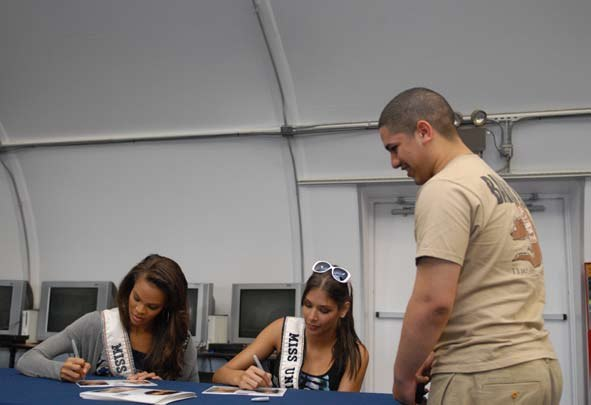 Miss USA contestants give autographs while visiting Guantanamo