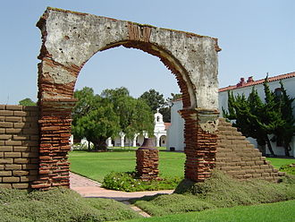 History of California - The courtyard of Mission San Luis Rey de Francia, with California's oldest pepper tree (Schinus molle), planted in 1830, visible through the arch.