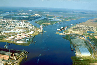 Mobile County, Alabama - Aerial view of the Mobile River at its confluence with Chickasaw Creek. This photograph was taken around 1990 during construction of the Cochrane-Africatown bridge carrying U.S. Route 90 across the river.