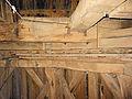 Molen De Bataaf kruiwerk met houten rollenwagen en ijzeren rollen.jpg