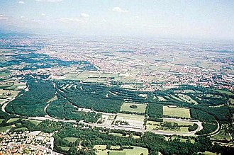 Autodromo Nazionale Monza - An aerial photo of the Autodoromo of Monza with the village of Villasanta in the upper part. The city of Monza is southwards off to the right of the photo.