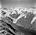 Muir Glacier, tidewater glacier terminus, glacial remnents, hanging glaciers, and glacial flour in the water, September 12, 1980 (GLACIERS 5752).jpg