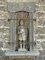 Murol maison abbé d'Estaing dépendance statue St Ferreole.JPG