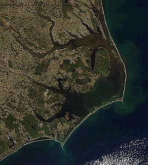 Cape Lookout (North Carolina) - Cape Lookout appears left of center near the bottom of this view of North Carolina Coast. Orbital photo courtesy NASA.
