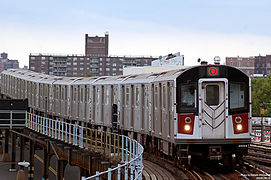 A number 6 train, consisting of R142A train cars, approaching the Parkchester station