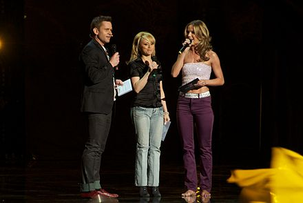 Rickard Olsson, Nanne Grönvall and Marie Serneholt during the first semi-final broadcast
