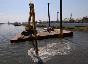 Civil engineering and infrastructure repair in New Orleans after Hurricane Katrina - Flexifloat barge delivers 15,000 pound sand bags to plug a breach in the 17th Street Canal. (USACE)