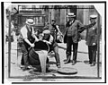 New York City Deputy Police Commissioner John A. Leach, right, watching agents pour liquor into sewer following a raid during the height of prohibition LCCN99405169.jpg