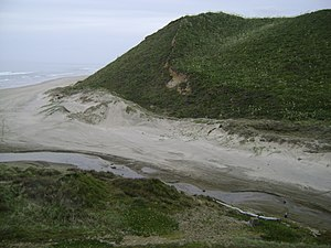 Battle of Moremonui - The mouth of Moremonui Gully viewed from the southern side, with battle monument at lower right