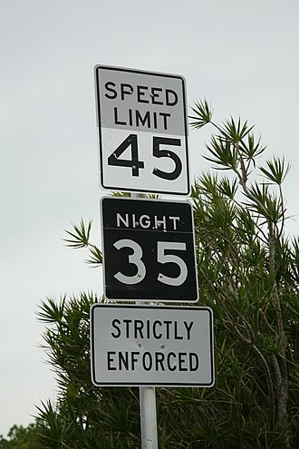 Speed limits in the United States - Night speed limit in the Key Deer habitat on the Florida Keys. Note the nonreflective backing of the day speed limit number. At night, only the number on the lower sign is visible in the headlights.