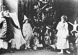 Nutcracker -Scene from Act I -Sergei Legat as Nutcracker, Stanislava Stanislavovna Belinskaya as Clara, & Unidentified as a Gingerbread Soldier -1892.jpg