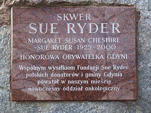 "Sue Ryder - Plaque at ""Sue Ryder Square"" in Gdynia, Poland, stating that she was an honorary citizen of the city and that her Foundation had helped fund a cancer ward there"