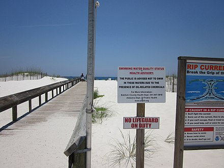 Sign in Orange Beach, Alabama advising against swimming due to the oil spill Orange Beach Do Not Swim sign walkway.JPG