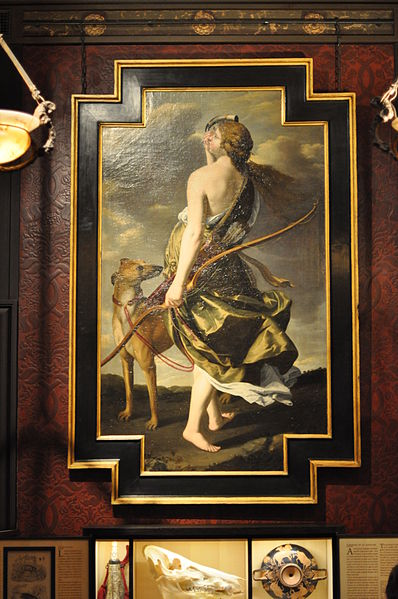 painting of Roman goddess Diana with bow and hunting dog