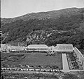 Ornamental garden surrounded by brick wall and six iron framed glass-houses. Location Identified as Kylemore Gardens, Kylemore, Co Galway (16140098514).jpg