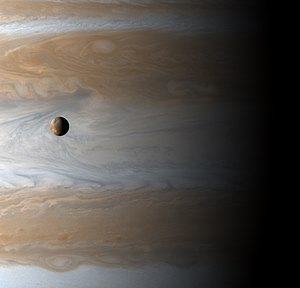 Transit (astronomy) - Io transits across Jupiter as seen by Cassini spacecraft