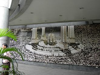 Democracy Monument - Crowds rally at the Democracy Monument in 1973 to protest against the military regime (display at the Memorial to 14 October 1973, Bangkok)