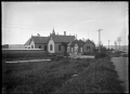 Palmerston District High School, Otago, with a memorial arch leading in ATLIB 303158.png