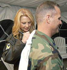 Loveless signing a shirt at the Wright-Patterson Air Force Base in July 2004