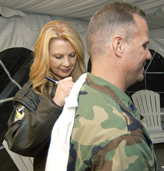 Patty Loveless - Loveless signing a shirt at the Wright-Patterson Air Force Base in July 2004