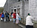 People filling their bottles with Holy Water from Lourdes - panoramio.jpg