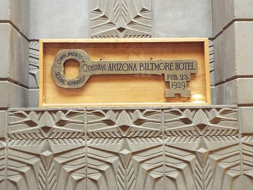 Wooden key on display above the fireplace in the History Room Phoenix-Building-Arizona Biltmore Hotel History room-1929-5.jpg