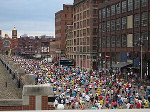 Pittsburgh Marathon - Runners pass warehouses in the Strip District neighborhood.